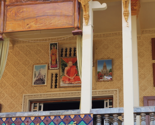Picture of religious icons above entryway. Photo of now-deceased famous monk teacher Som Bun Thoeun is the largest and most central icon.